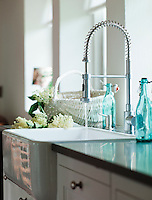The traditional kitchen has modern fittings such as this spring attached tap attachment over the butler's sink