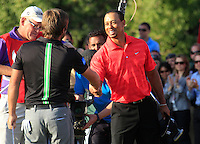 Robert Rock (ENG) wins and Tiger Woods (USA) shakes hands on the 18th hole during Sunday's Final Round of the HSBC Golf Championship at the Abu Dhabi Golf Club, United Arab Emirates, 29th January 2012 (Photo Eoin Clarke/www.golffile.ie)