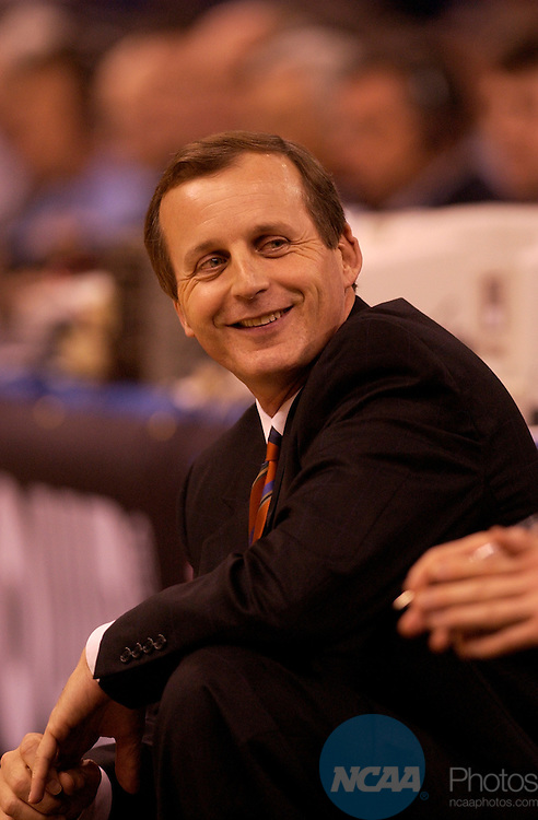 5 April 2003: Texas head coach Rick Barnes smiles at his team on the bench during the Division I Men's Final Four semifinal game held in the Louisiana Superdome in New Orleans, LA. Syracuse went on to defeat Texas 95-84 to advance to the championship game. Photo by Ryan McKee/NCAA Photos