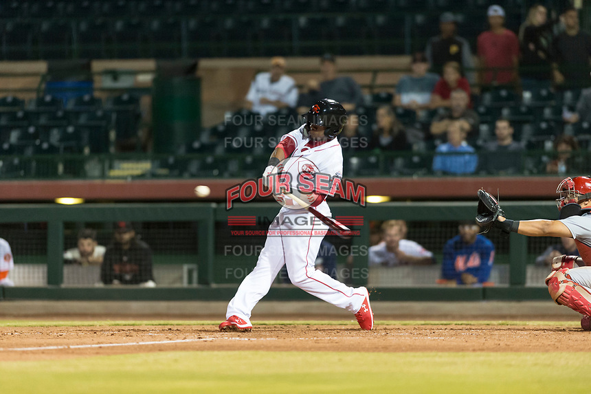 Scottsdale Scorpions pinch hitter Shed Long (6), of the Cincinnati Reds organization, swings at a pitch in front of catcher Jeremy Martinez (4) during an Arizona Fall League game against the Surprise Saguaros at Scottsdale Stadium on October 15, 2018 in Scottsdale, Arizona. Surprise defeated Scottsdale 2-0. (Zachary Lucy/Four Seam Images)