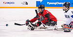 PyeongChang 15/3/2018 - Rob Armstrong (#6), of Mississauga, ON, gets a shot away as Canada takes on Korea in semifinal hockey action at the Gangneung Hockey Centre during the 2018 Winter Paralympic Games in Pyeongchang, Korea. Photo: Dave Holland/Canadian Paralympic Committee