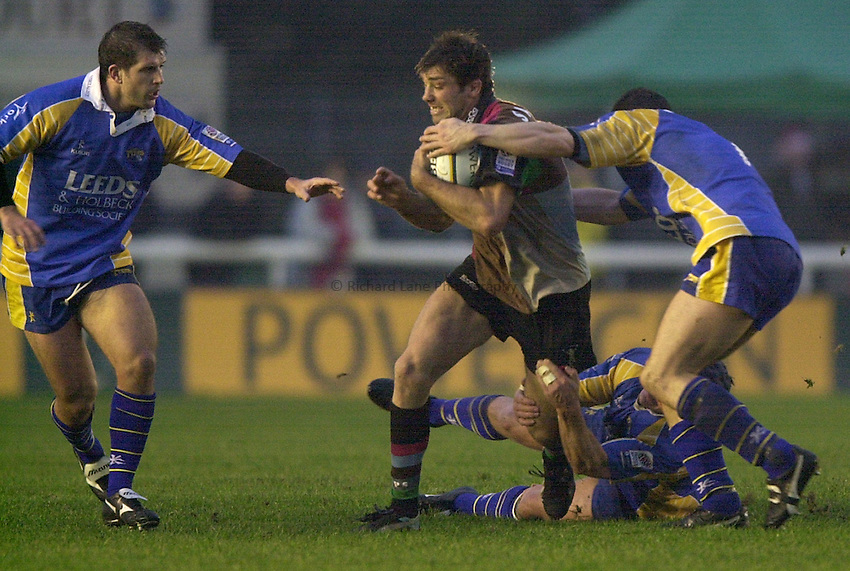 Photo. Richard Lane.NEC Harlequins v Leeds Tykes at the Stoop. Powergen Cup. 21/12/2002.Pat Sanderson attacks.