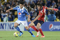 BOGOTÁ -COLOMBIA, 11-10-2014. Omar Vasquez (Izq) jugador de Millonarios disputa el balón con John Hernandez (Der) jugador de Independiente Medellín durante partido por la fecha 14 de la Liga Postobón II 2014 jugado en el estadio Nemesio Camacho el Campín de la ciudad de Bogotá./ Omar Vasquez (L) player of Millonarios fights for the ball with John Hernandez (R) player of  Independiente Medellin during the match for the 14th date of the Postobon League II 2014 played at Nemesio Camacho El Campin stadium in Bogotá city. Photo: VizzorImage/ Gabriel Aponte / Staff