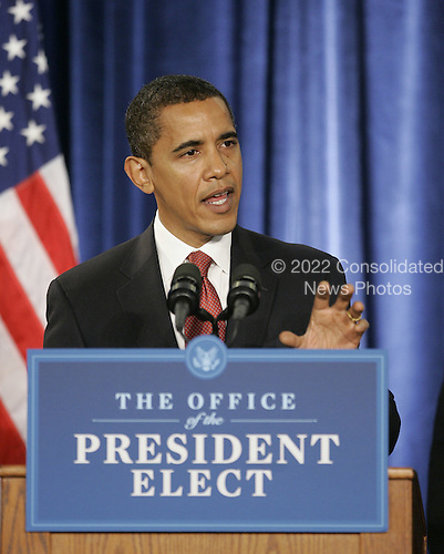 Chicago, IL - November 24, 2008 -- United States President-elect Barack Obama answers questions from the press after introducing his economic team during a news conference on Monday, November 24, 2008 in Chicago. Obama aides on Sunday called on the new congress, which convenes January 6, 2009, to pass legislation consistent with Obama's economic plans. .Credit: Brian Kersey - Pool via CNP