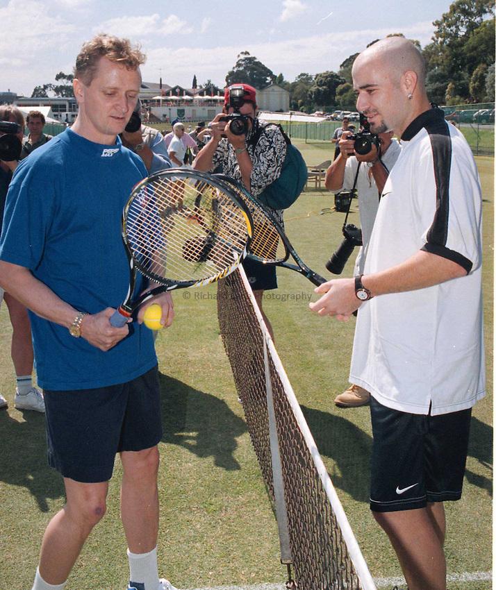 Photo. Abbey Wells.Austrailan Open, Melbourne, Austraila.1996.Andre Agassi with Swantz