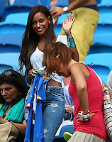 Fanny Neguesha, the fiancee of Mario Balotelli of Italy, waves to photographers before kick off