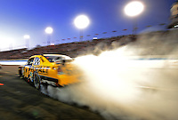Nov. 9, 2008; Avondale, AZ, USA; NASCAR Sprint Cup Series driver Matt Kenseth burns out after pitting during the Checker Auto Parts 500 at Phoenix International Raceway. Mandatory Credit: Mark J. Rebilas-