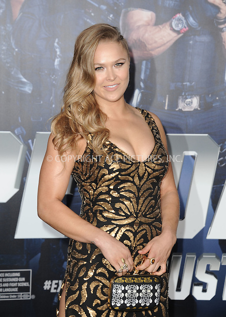 ACEPIXS.COM<br /> <br /> August 11 2014, LA<br /> <br /> Ronda Rousey arriving at the premiere of  'The Expendables 3' at the TCL Chinese Theatre on August 11, 2014 in Hollywood, California.<br /> <br /> <br /> By Line: Peter West/ACE Pictures<br /> <br /> ACE Pictures, Inc.<br /> www.acepixs.com<br /> Email: info@acepixs.com<br /> Tel: 646 769 0430