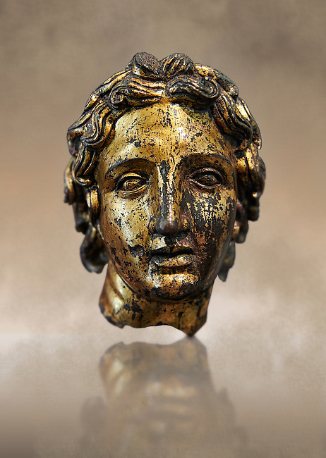 Roman bust of Alexander the Great, 2nd cent B.C bronze with gold leaf. The head is from a smaller than life size statue. The elongated curls, the parted locks and the diadem that fastens the hair at the back, are clear indications that the head is a portrait of the Macedonian King Alexander the Great (356-323 B.C.). Inv 66177, The National Roman Museum, Rome, Italy