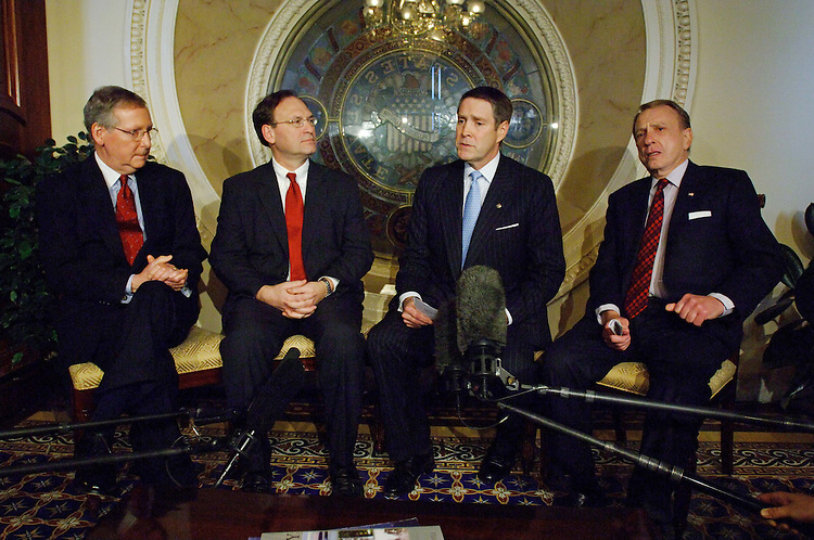 01/25/06.ALITO WITH GOP LEADERS--Senate Majority Whip Mitch McConnell, R-Ky., U.S. Supreme Court nominee Samuel A. Alito Jr., Senate Majority Leader Bill Frist, R-Tenn., and Senate Judiciary Chairman Arlen Specter, R-Pa., during a photo opp in McConnell's office in the U.S. Capitol. Debate on Alito's nomination has begun on the Senate floor..CONGRESSIONAL QUARTERLY PHOTO BY SCOTT J. FERRELL