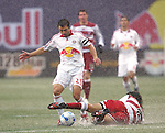 15 April 2007: Dallas's Juan Toja (right) slides on the wet turf to tackle the ball away from New York's Dema Kovalenko (21). The New York Red Bulls defeated FC Dallas 3-0 at Giants Stadium in East Rutherford, New Jersey in an MLS Regular Season game.