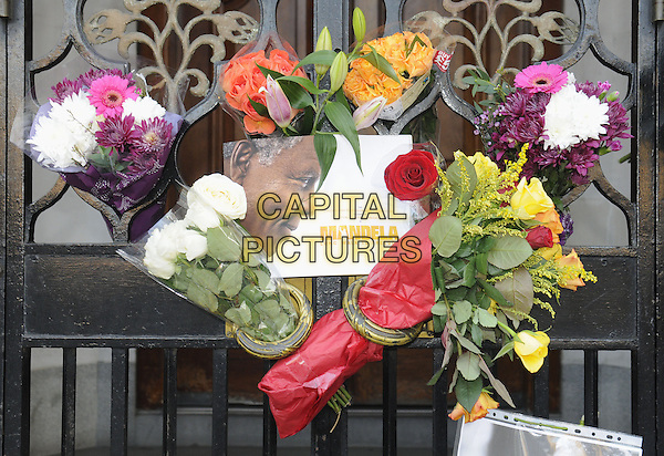 LONDON, ENGLAND, DECEMBER 06: Tributes are left outside South Africa House, following the death of Nelson Mandela aged 95, on 6th December 2013, London, England. <br /> CAP/PP/BK<br /> &copy;Bob Kent/PP/Capital Pictures