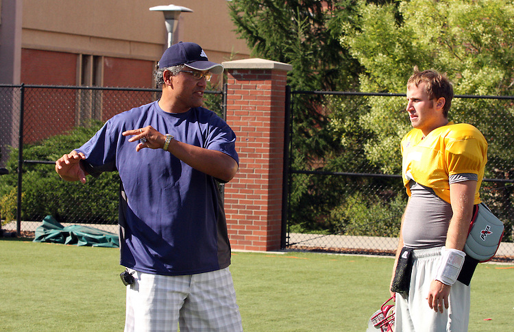 "Jack Thompson, former outstanding Washington State and NFL quarterback, nicknamed the ""The Throwin' Samoan"", gives some passing tips to redshirt freshman quarterback, J.T. Levenseller, after the completion of Washington State's practice in Pullman, Washington, on August 10, 2008."
