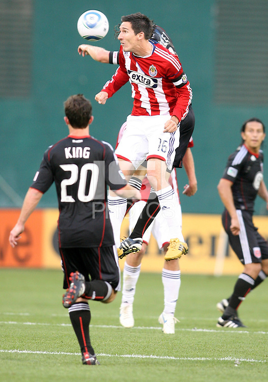 Carey Talley #8 of D.C. United loses a header to Sacha Kljestan #16 of Chivas USA during an MLS match at RFK Stadium, on May 29 2010 in Washington DC. United won 3-2.