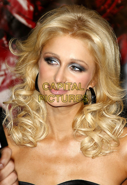 """PARIS HILTON.""""Repo! The Genetic Opera"""" Special Screening presented by Lionsgate, Twisted Pictures and Planet Hollywood held inside Planet Hollywood Resort Hotel and Casino, Las Vegas, Nevada, USA..November 6th, 2008.headshot portrait black hoop earrings eyeshadow silver .CAP/ADM/MJT.© MJT/AdMedia/Capital Pictures."""