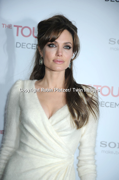 "Angelina Jolie at The World Premiere of ""The Tourist"" on December 6, 2010 at The Ziegfeld Theatre in New York City. The film stars Angelina Jolie and Johnny Depp."