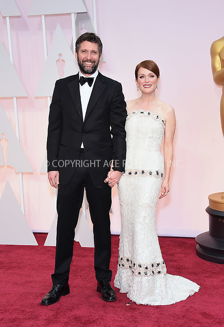 WWW.ACEPIXS.COM<br /> <br /> February 22 2015, Los Angeles Ca.<br /> <br /> Actress Julianne Moore (R) and artist Bart Freundlich arriving at the 87 th Annual Academy Awards at the Hollywood and Highland center on February 22 2015 in Hollywood CA.<br /> <br /> <br /> Please byline: Z15/ACE Pictures<br /> <br /> ACE Pictures, Inc.<br /> www.acepixs.com<br /> Email: info@acepixs.com<br /> Tel: 646 769 0430