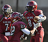 Glen Cove running back No. 8 David Bull, right, gets congratulated by No. 22 Sharayad Letellier after rushing for a touchdown during a Nassau County varsity football Conference III semifinal against Bethpage at Hofstra University on Saturday, Nov. 14, 2015. Glen Cove won by a score of 21-0.<br /> <br /> James Escher