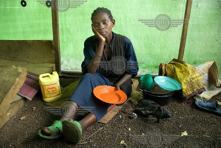 Furaha Markalimba, a new arrival at the Mugunga I IDP (Internally Displaced Persons) camp, waits for food aid distribution.