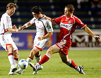 Chicago Fire forward Chad Barrett (9) tries to take the ball from New England Revolution defender Jay Heaps (6). The Chicago Fire defeated the New England Revolution 2-1 in the quarterfinals of the U.S. Open Cup at Toyota Park in Bridgeview, IL on August 23, 2006...