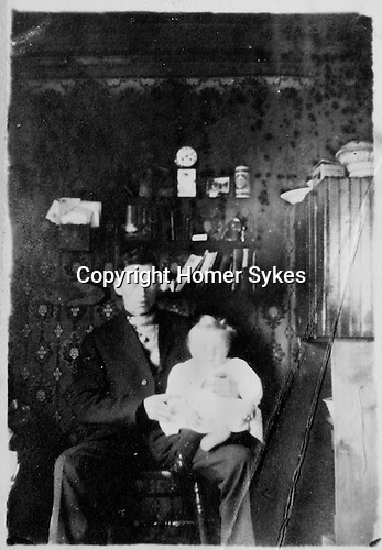 Bernard William Sykes with his first child Homer Warwick Sykes (born 1909) Luseland, Saskatchewan,  Canada. Interior HWS looks like about a year old. Probably about 1910.