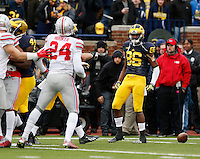 Ohio State Buckeyes safety Malik Hooker (24) gets into a shouting match with Michigan Wolverines wide receiver Jehu Chesson (86) after a kickoff during the NCAA football game at Michigan Stadium in Ann Arbor on Nov. 28, 2015. Ohio State won 42-13. (Adam Cairns / The Columbus Dispatch)