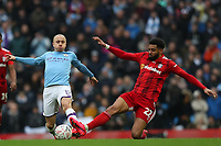 26th January 2020; Etihad Stadium, Manchester, Lancashire, England; English FA Cup Football, Manchester City versus Fulham; Cyrus Christie of Fulham slide tackles Angelino of Manchester City