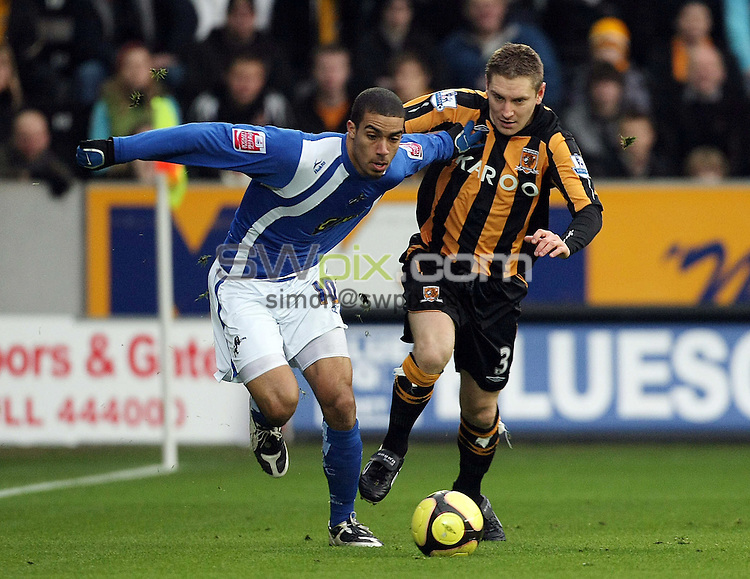 PICTURE BY VAUGHN RIDLEY/SWPIX.COM - Football - FA Cup, 4th Round - Hull City v Millwall - KC Stadium, Hull, England - 24/01/09...Copyright - Simon Wilkinson - 07811267706...Millwall's Lewis Grabban brushes past Hull's Andy Dawson.