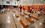 The Douglas High freshman football team practices inside the school gym, in Minden, Nev., on Tuesday, Aug. 27, 2013, due to unhealthy air caused by smoke from the Rim fire in Northern California. Air quality reached 343 in Minden earlier Tuesday.<br /> Photo by Cathleen Allison