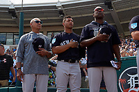 New York Yankees (L-R) Reggie Jackson, Gleyber Torres, and Marcus Thames stand for the national anthem before a Grapefruit League Spring Training game against the Detroit Tigers on February 27, 2019 at Publix Field at Joker Marchant Stadium in Lakeland, Florida.  Yankees defeated the Tigers 10-4 as the game was called after the sixth inning due to rain.  (Mike Janes/Four Seam Images)