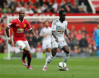 Pictured: Nathan Dyer of Swansea (R) against Ashley Young of Manchester United. Saturday 16 August 2014<br />