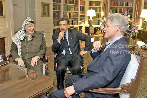 United States President Bill Clinton Meets With Palestinian Authority Chairman Yassir Arafat (along with Chairman Arafat 's Press Secretary Nabil Aburedina) in the White House Library in Washington, D.C. on January 2, 2001.    .Mandatory Credit: William Vasta - White House via CNP
