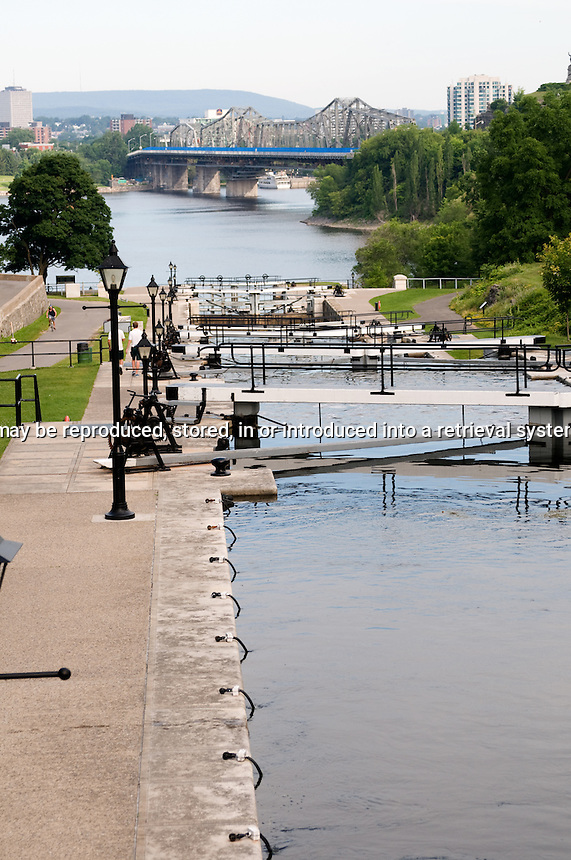Locks on the Rideau canal down to the Ottawa River with the Alexandra bridge in the background