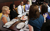 United States President Barack Obama (3rd L) chats with campaign volunteers during a lunch August 10, 2011 at Ted's Bulletin in Washington, DC. Obama had lunch with campaign volunteers who were selected based on essays they wrote about organizing.  .Credit: Alex Wong / Pool via CNP