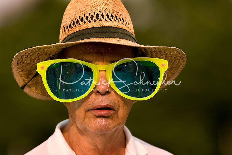 A man wears oversized glasses during the 52nd Annual Grandfather Mountain Highland Games in Linville, NC.