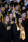 Graduates Emily Nagel and Jessica Leman listen to the National Anthem during the 2013 Western Nevada College Commencement at the Pony Express Pavilion, in Carson City, Nev., on Monday, May 20, 2013. .Photo by Cathleen Allison