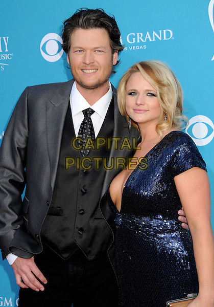 BLAKE SHELTON & MIRANDA LAMBERT .Arrivals - 45th Annual Academy Of Country Music Awards held at the MGM Grand Garden Arena, Las Vegas, NV, USA, 18th April 2010..ACM ACMs half length black suit tie waistcoat blue dress cleavage boob low cut sequined sequin navy .CAP/ADM/BP.©Byron Purvis/AdMedia/Capital Pictures.