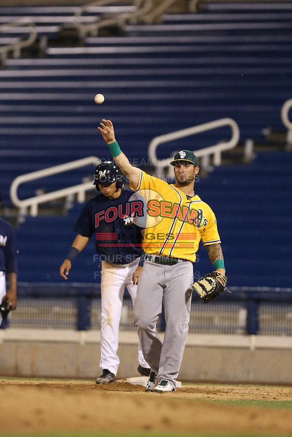 Rangel Ravelo of the AZL Athletics in the field at first base during a game against the AZL Brewers at Maryvale Baseball Park on June 30, 2015 in Phoenix, Arizona. Brewers defeated Athletics, 4-2. (Larry Goren/Four Seam Images)