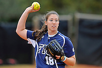 11 February 2012:  FIU's Jenn Gniadek (18) throws to first as the University of Louisville Cardinals defeated the FIU Golden Panthers, 4-2, as part of the COMBAT Classic at the FIU Softball Complex in Miami, Florida.