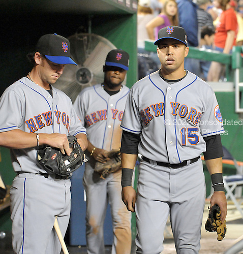 Washington, D.C. - June 6, 2009 -- New York Mets players Jeremy Reed (18), left, Wilson Valdez (4), center, and Carlos Beltran (15), left, leave the dugout after the game against the Washington Nationals at Nationals Park in Washington, D.C. on Saturday, June 6, 2009.  The Nationals won the game 7 - 1..Credit: Ron Sachs / CNP.(RESTRICTION: NO New York or New Jersey Newspapers or newspapers within a 75 mile radius of New York City)