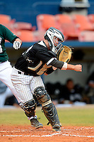 Long Island Blackbirds catcher Chris Untereiner #18 throws to first during a game against the Dartmouth Big Green at Chain of Lakes Stadium on March 17, 2013 in Winter Haven, Florida.  Dartmouth defeated Long Island 11-4.  (Mike Janes/Four Seam Images)