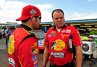 Nov. 13, 2009; Avondale, AZ, USA; NASCAR Sprint Cup Series driver Martin Truex Jr (left) talks with crew chief Kevin Manion during practice for the Checker O'Reilly Auto Parts 500 at Phoenix International Raceway. Mandatory Credit: Mark J. Rebilas-