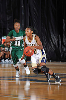 11 November 2011:  FIU's Jerica Coley (22) drives the ball up court while being pursued by Jacksonville's Ronisha Mitchell (11) in the second half as the FIU Golden Panthers defeated the Jacksonville University Dolphins, 63-37, at the U.S. Century Bank Arena in Miami, Florida.