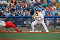 Charlotte Stone Crabs first baseman Russ Olive (34) waits for a pickoff attempt throw as Ryan Costello (13) dives back to the bag during a Florida State League game against the Fort Myers Miracle on April 6, 2019 at Charlotte Sports Park in Port Charlotte, Florida.  Fort Myers defeated Charlotte 7-4.  (Mike Janes/Four Seam Images)
