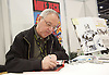 London Super Comic Convention <br /> at ExCel London, Great Britain <br /> 20th February 2016 <br /> <br /> Mike Zeck signs copies of Marvel Super Heros and Captain America <br /> <br /> <br /> Photograph by Elliott Franks <br /> Image licensed to Elliott Franks Photography Services