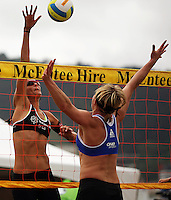 NZ's Anna Scarlett tries to beat Germany's Helke Classen at the net during the 2009 McEntee Hire NZ Beach Volleyball Tour - Women's final at Oriental Parade, Wellington, New Zealand on Sunday, 11 January 2009. Photo: Dave Lintott / lintottphoto.co.nz.