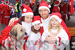 Suzanne, Maisie, Garry and Edie Hall Castlegregory with their dog Doffo at the Santa run in Killarney on Saturday..