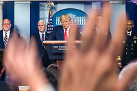 US President Donald J. Trump, surrounded by members of the White House Coronavirus Task Force, delivers remarks on the pandemic in the press briefing room of the White House in Washington, DC, USA, 22 March 2020. Efforts to contain the coronavirus COVID-19 pandemic have caused travel disruptions, sporting event cancellations, runs on cleaning supplies and food and other inconveniences.<br /> Credit: Jim LoScalzo / Pool via CNP/AdMedia
