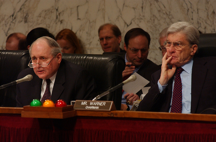 2/13/03.DEFENSE AUTHORIZATION REQUEST--Sen. Elizabeth Dole, R-N.C., talks with Defense Secretary Donald H. Rumsfeld before the Senate Armed Services hearing on the defense authorization request for Fiscal Year 2004 and on the defense program of the future. Gen. Richard B. Myers, USAF chairman of the Joint Chiefs of Staff, also testified..CONGRESSIONAL QUARTERLY PHOTO BY SCOTT J. FERRELL