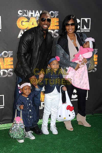 GREG JENNINGS and family.1st Annual Cartoon Network Hall of Game Awards held at Barker Hangar, Santa Monica, California, USA..February 21st, 2011.full length kids children black leather jacket sunglasses shades pink white jeans denim.CAP/ADM/BP.©Byron Purvis/AdMedia/Capital Pictures.
